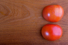 Orange on a table. Sliced tomato on a table Royalty Free Stock Images