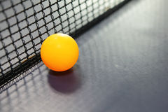 Orange table tennis ball Stock Images