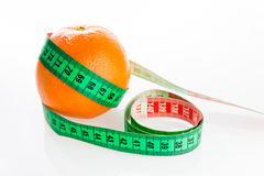 Orange with tailor s ruler. Oranges with tailor s ruler. Fruit healthy vitamin diet Stock Photo