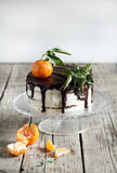 Orange tangerine cake with chocolate and cream Royalty Free Stock Image