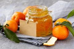 Orange (tangerine) jam in a glass jar Royalty Free Stock Photo