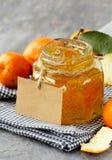 Orange (tangerine) jam in a glass jar Royalty Free Stock Image