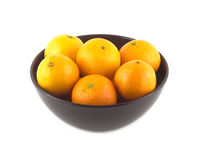 Orange tangerines inside china bowl isolated closeup. Orange tangerines inside purple china bowl isolated closeup royalty free stock images