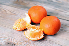 Orange tangerines on a wooden table Royalty Free Stock Image