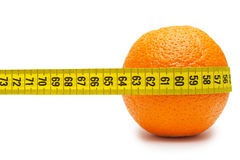 Orange and tape measure isolated. On white Royalty Free Stock Image