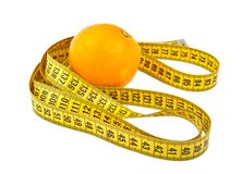 Orange and tape measure isolated on white Royalty Free Stock Image