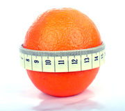 Orange with tape measure Royalty Free Stock Photo
