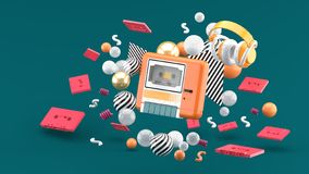 An orange tape player surrounded by tapes and colorful balls on a green background. royalty free stock photography