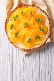 Orange tart with cream and mint. vertical top view Royalty Free Stock Photos
