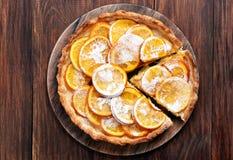 Orange tart on wooden background Stock Image