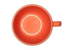 Orange Tasse Kaffee auf einem leeren weißen Hintergrund Stockbilder
