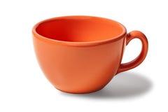 Orange Tasse Kaffee leer auf einem weißen Hintergrund Stockbild