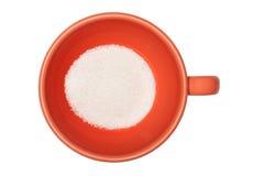 Orange Tasse Kaffee mit Zucker auf einem weißen Hintergrund Stockfotos