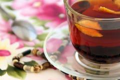 Orange tea on the flower background Stock Photography