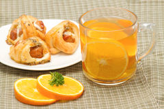 orange tea with little  croissant Royalty Free Stock Photos