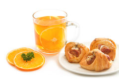 Orange tea with little  croissant Stock Photography
