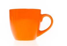 The orange tea mug Royalty Free Stock Photography
