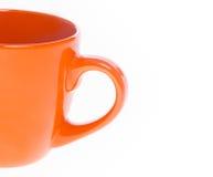 The orange tea mug Royalty Free Stock Images