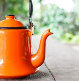 Orange tea pot Royalty Free Stock Images