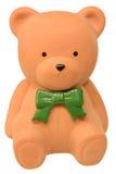 Orange teddy bear money box stock image