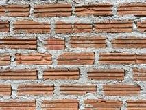 Orange tegelsten- och betongväggbackgound Royaltyfri Fotografi