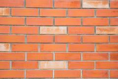 Orange tegelstenvägg Arkivfoton