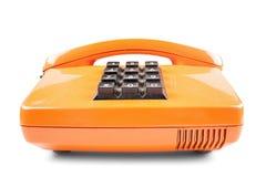 Orange Telefon mit Schatten auf weißem Hintergrund Stockfotos