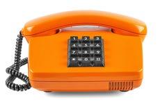 Orange Telefon mit Schatten auf weißem Hintergrund Lizenzfreie Stockbilder