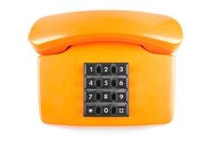 Orange Telefon mit Schatten auf weißem Hintergrund herauf Seite Lizenzfreie Stockfotos