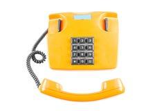 Orange Telefon mit Schatten auf weißem Hintergrund oben Lizenzfreie Stockfotografie