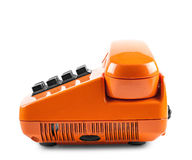 Orange Telefon mit Schatten auf weißer Hintergrundseite Stockbild