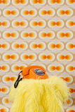 Orange Telephone. Standing on a Yellow Plush Blanked Royalty Free Stock Photo