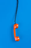 Orange telephone hook Royalty Free Stock Images