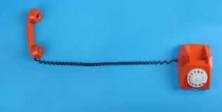 Free Orange Telephone Over Blue Background Stock Image - 12899751
