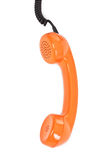 Orange telephone receiver over white Stock Image