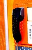 Orange telephone receiver with shawdow light. Stock Images