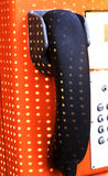 Orange telephone receiver with shawdow light. Royalty Free Stock Images