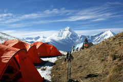 Orange tent in the background of the mountains of Nepal Royalty Free Stock Image