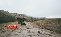 Orange Tent camping in foggy Mountains Royalty Free Stock Photography