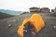 Orange Tent camping in Mountains Stock Photography