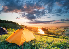 Orange tent on a hill above the river Royalty Free Stock Photo