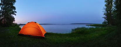 Orange tent by the lake royalty free stock photography