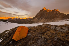Orange tent in the mountains Stock Image