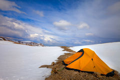 Orange tent in snow mountains Royalty Free Stock Photography