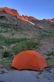 Orange tent, sunrise in the mountains Royalty Free Stock Image