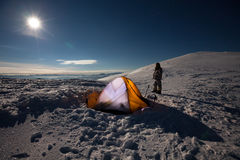 Orange tent in winter forest Royalty Free Stock Image