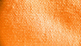 Orange textile background. Details of a piece of orange colored fabric or textile.  Suitable for an abstract background Stock Images