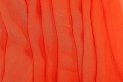 Orange textile fabrics Stock Images