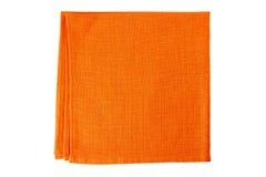 Orange textile napkin on white Royalty Free Stock Image