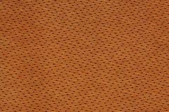 Orange Textilhintergrund Lizenzfreie Stockbilder